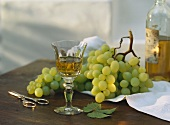 A Single Glass of White Wine with Green Grapes