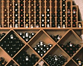 Numerous bottles stored on shelving in a wine shop