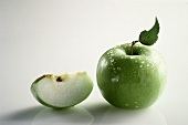 Whole Granny Smith Apple with Water Drops; Apple Slice