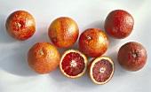 Several Blood Oranges; One Cut in Half