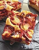 Tray-baked plum cake on cake slice