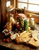 Various fruits & vegetables in preserving jars on wooden table