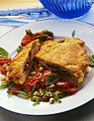 Stuffed pork escalope with tomatoes and spring onions