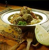 Liver dumplings on sauerkraut with roasted onions