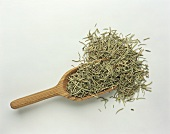 A scoop of dried rosemary needles