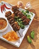 Grilled meat kebabs with spicy sauce