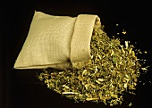 Dried golden rod falling out of linen bag