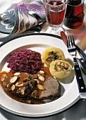 Stewed steak with red cabbage & stuffed potato dumplings
