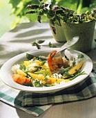 Rice with scampi, mangetout peas, mango and coriander