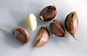 Several Cloves of Garlic; Peeled and Unpeeled