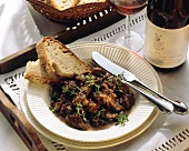 Oxtail ragout with thyme, decoration: white bread, red wine