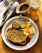 Stuffed roast veal with bread dumplings & vegetables
