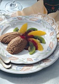 Mousse au chocolat with fruit salad and fruit sauce