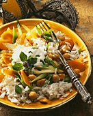 Rice dish with vegetables, chick peas & minted yoghurt dressing