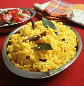Saffron rice with spices in serving dish