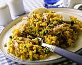 Saffron rice with mackerel fillets, eggs & peas on plate