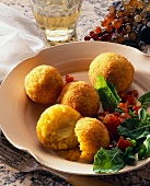 Supplì (rice balls with mozzarella stuffing, Italy)