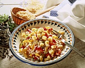 Rice salad with pepper and cheese cubes on plate