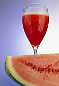 Glass of melon juice; piece of watermelon
