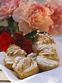 Cream puff filled with cream, decoration: peonies