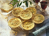 Small short pastry cheese tartlet with leeks