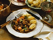 Boeuf Bourguignon with parsley potatoes on plate
