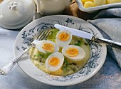 Eggs in mustard sauce garnished with dill on plate