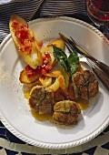 Stuffed pork fillets and bruschetta on plate