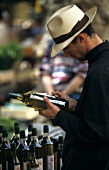 Man buying wine at the market in Aix-en-Provence
