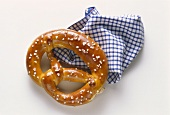 Pretzel with a Blue and White Gingham Napkin