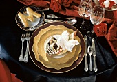 Single Place Setting with Gold Plates; Lace Napkin