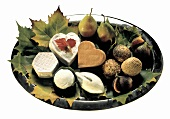 Cheese platter with pears, figs, sesame balls & leaves