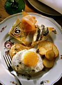 Veal with a Fried Egg and Potatoes and Raw Fish