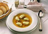 Broccoli-@@Griessnockerl-Soup-clear broth with gnocchi in deep plate