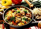 Pan-cooked rice dish with meatballs and vegetables