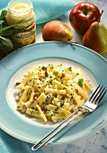 Cheese, pear and apple salad with hazelnuts and chives