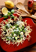 Broccoli & cauliflower salad with pine nuts on curly endive