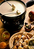 Cheese Fondue with a Basket of Bread Squares