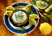 Artichoke stuffed with Garlic Yogurt decorated with Dill and Lemon Wedges