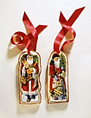 Two Decorated Gingerbread Ornaments with Red Ribbon