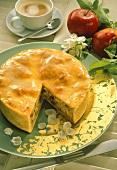 Double-crust apple pie with raisins, a piece cut