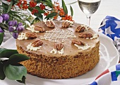 Nut sponge gateau with pecan nuts & white chocolate