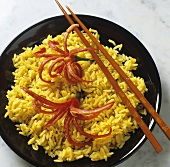 Curried rice garnished with chili flowers