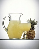 Pineapple Juice in a Pitcher and in a Glass