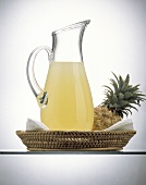Pineapple Juice in a Decanter; Pineapple in a Basket