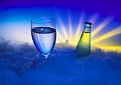 Glass and Bottle of Mineral Water; Clouds