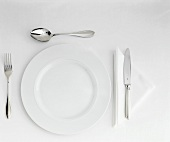 Table Setting with White Plate, Cutlery & Triangular Napkin