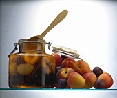 Assorted Stone Fruit in a Preserving Jar