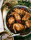 Baked rabbit pieces on red cabbage