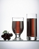 Two Glasses of Red Grape Juice; Grapes